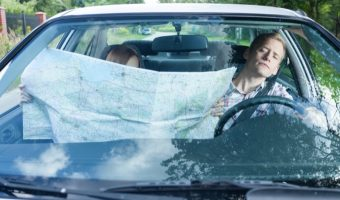 Woman with a map in a car